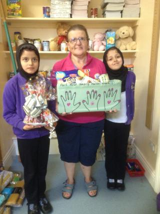 Mrs. Day receiving her hamper after being nominated by Park Road children for running the Poppy Appeal each year.(3)