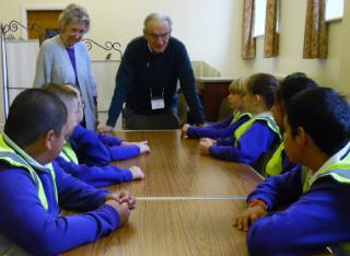 Pupils meeting volunteers John and Eileen Trevenna at the homeless shelter
